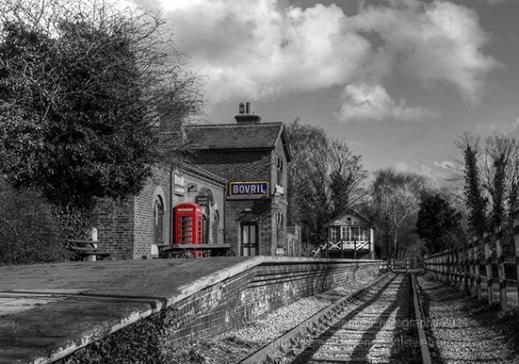 red phone box on the station platform